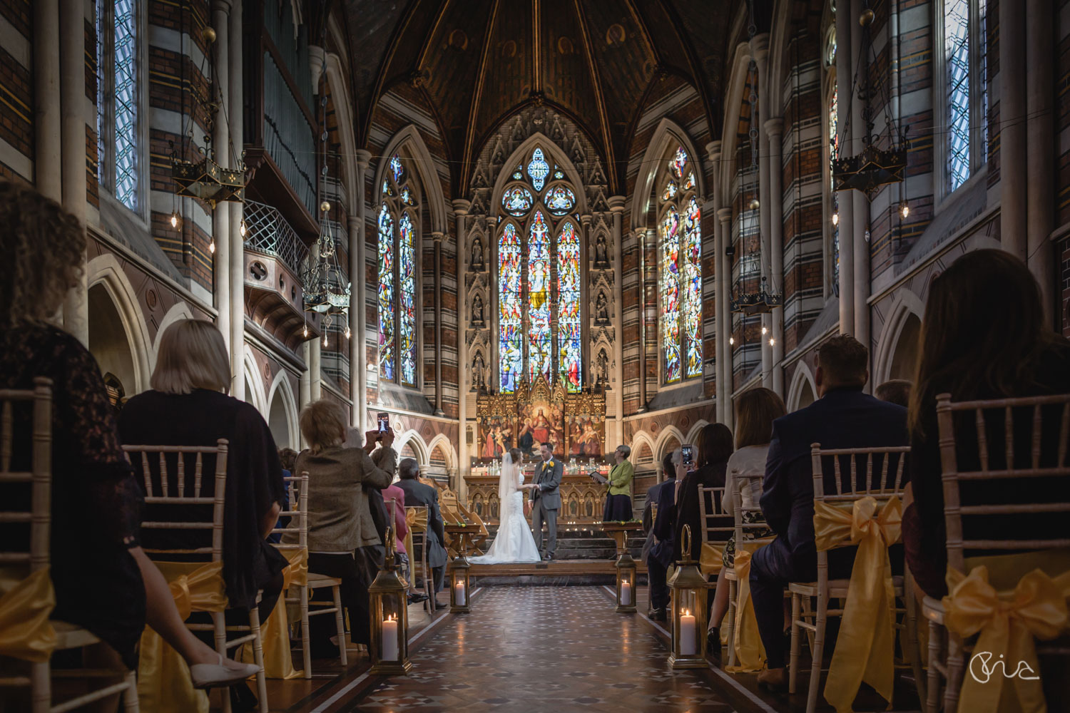 Wedding ceremony at Bride at at All Saints Chapel in Eastbourne